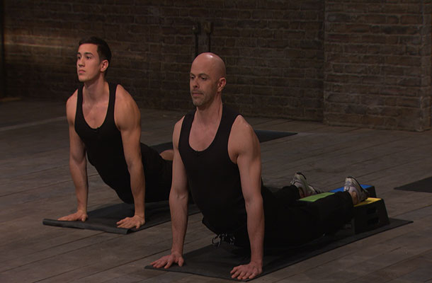 Image of flexible men stretching with a Beamblock.