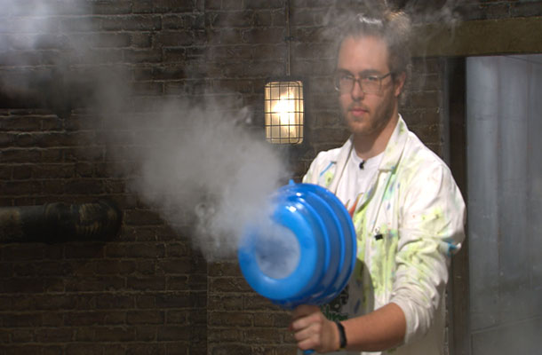 Sub science owner Marc with science gun and smoke in the Den.