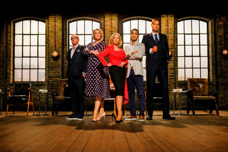5 people (Dragon's Den judges) standing, posing in front of the camera